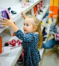 little-baby-climbs-on-showcase-to-takes-a-shoes-gy2bcha